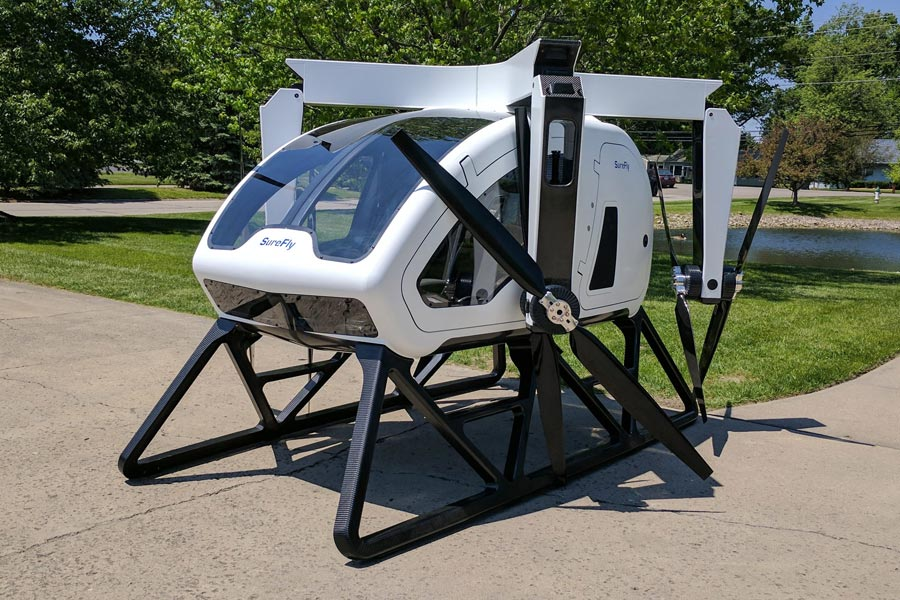 The SureFly Hybrid Helicopter with prop arms folded down.